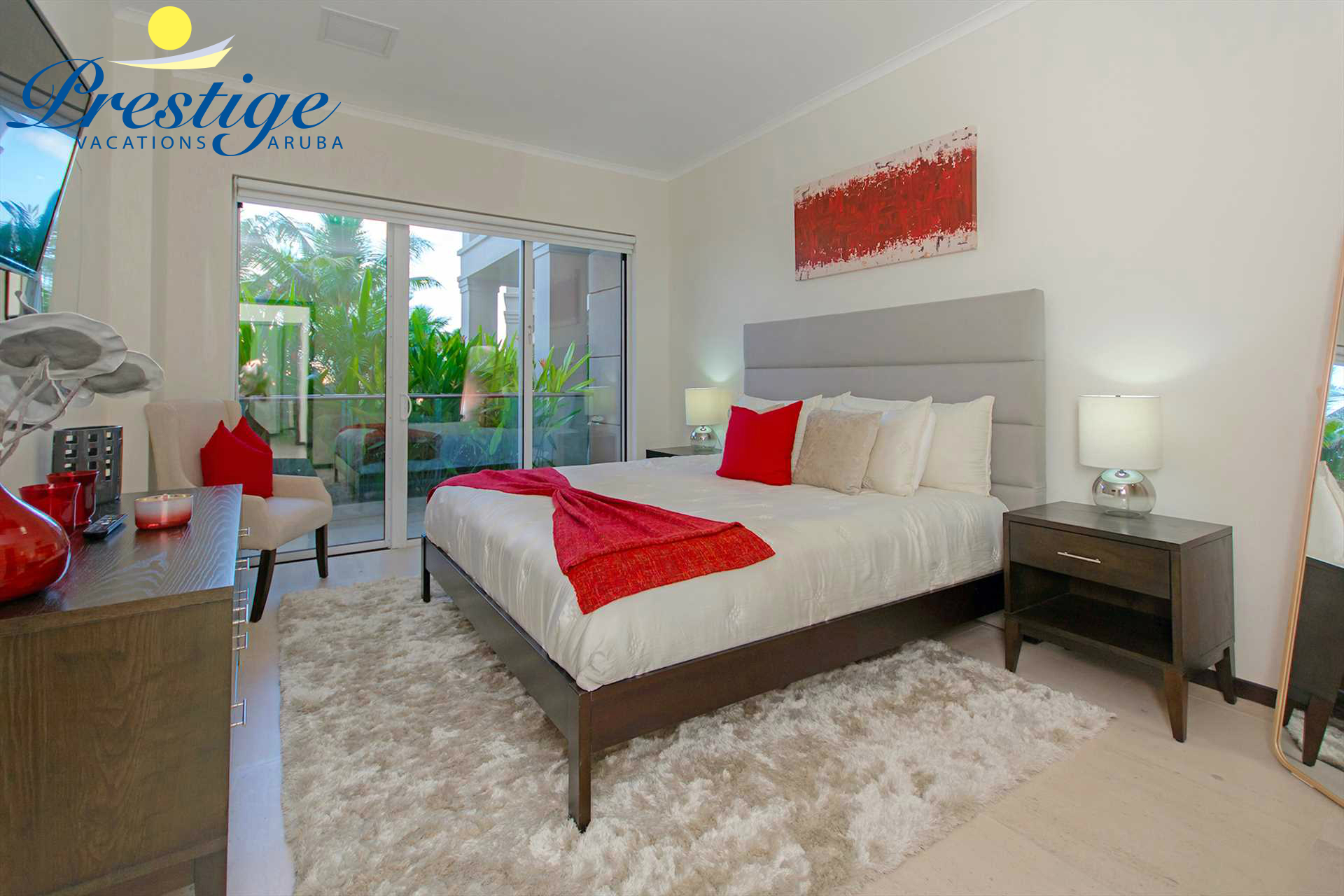 Master bedroom with king-size bed and access to the veranda