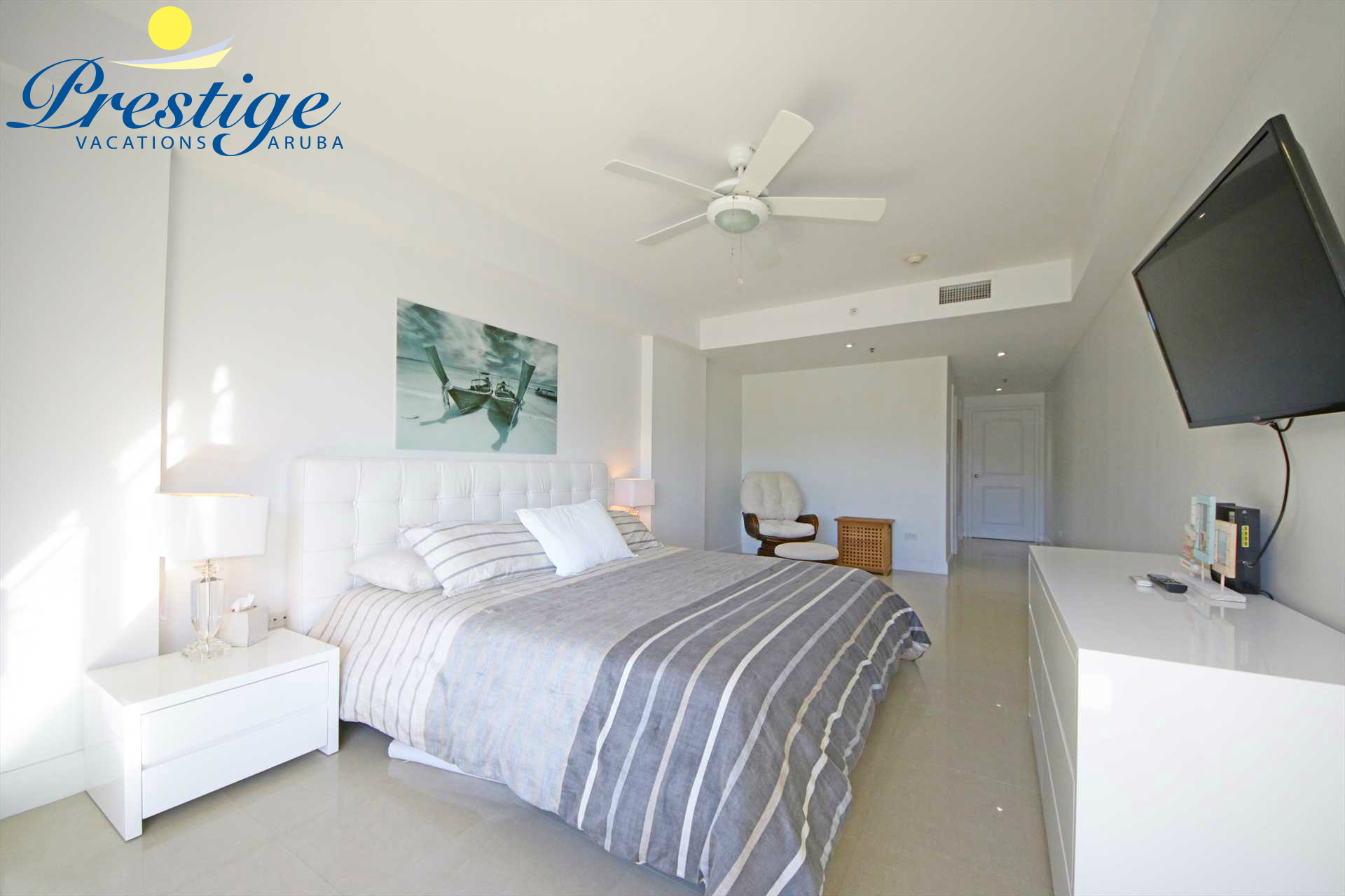 Master bedroom with TV and a swivel chair