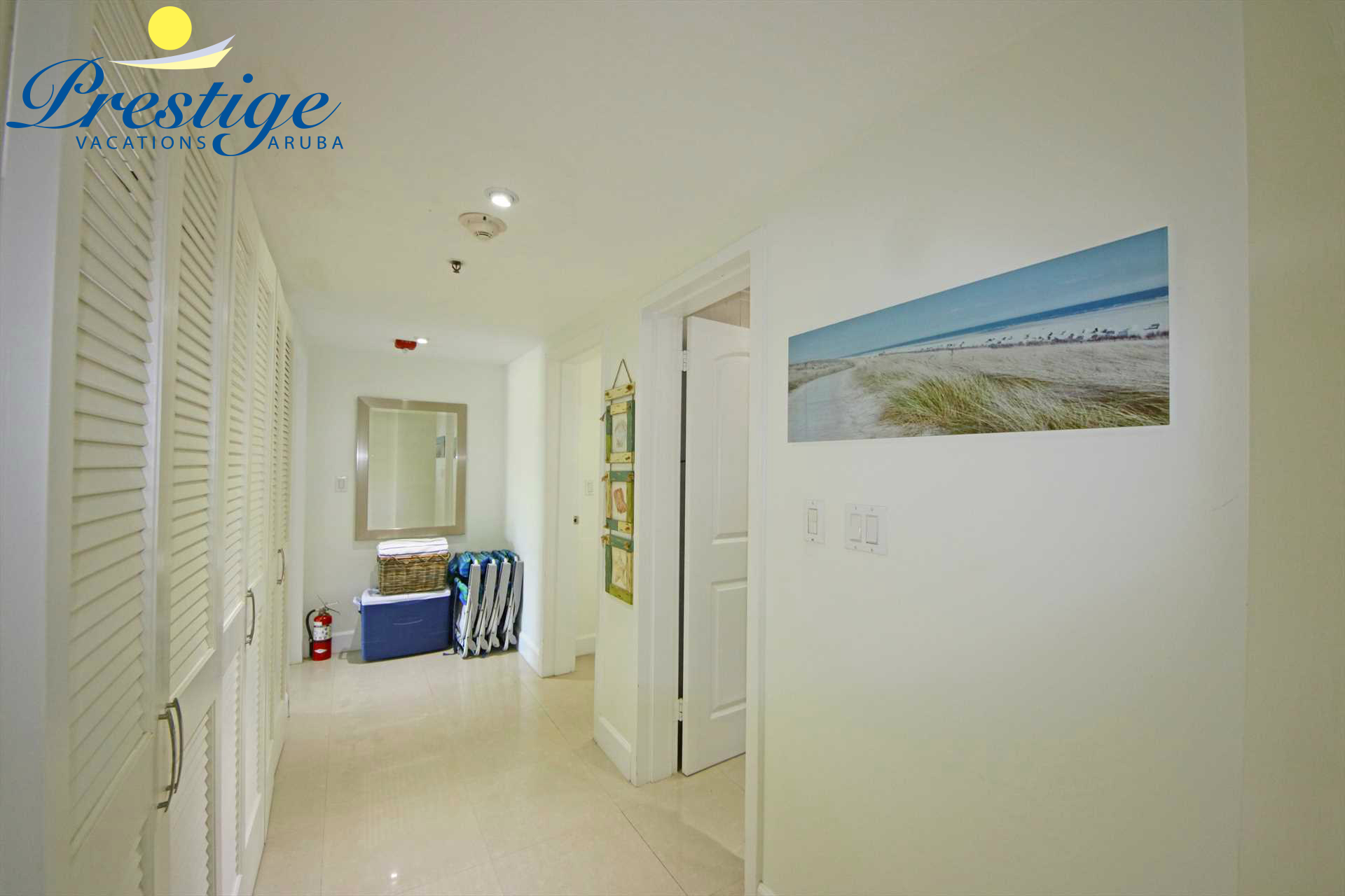 The corridor with laundry facility and access to the bedrooms
