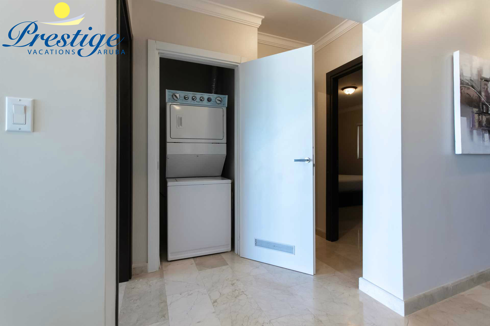 Washer and dryer are conveniently located in the condo