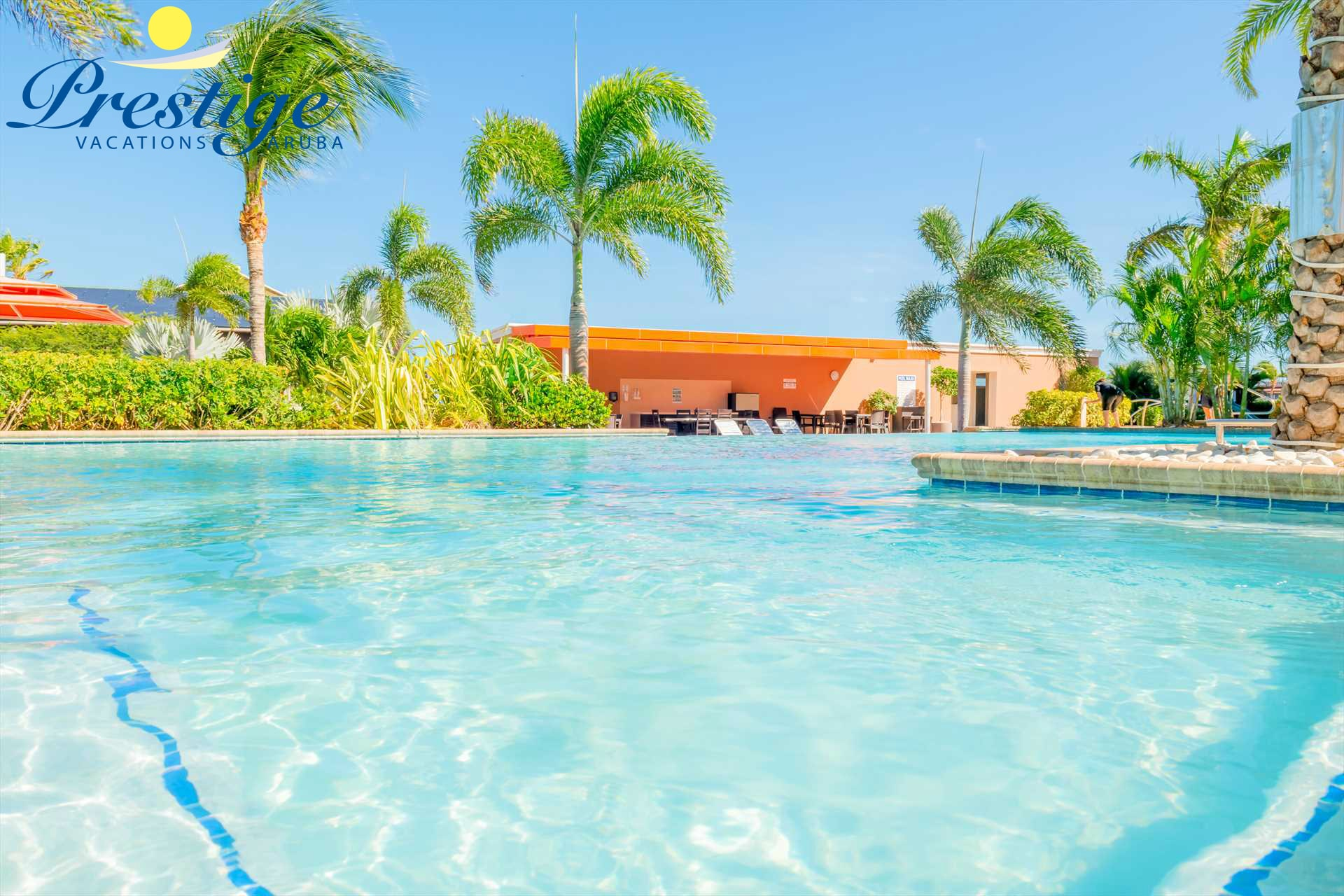 Indulge in the pool and unwind under the trees, the perfect Aruba vacation!