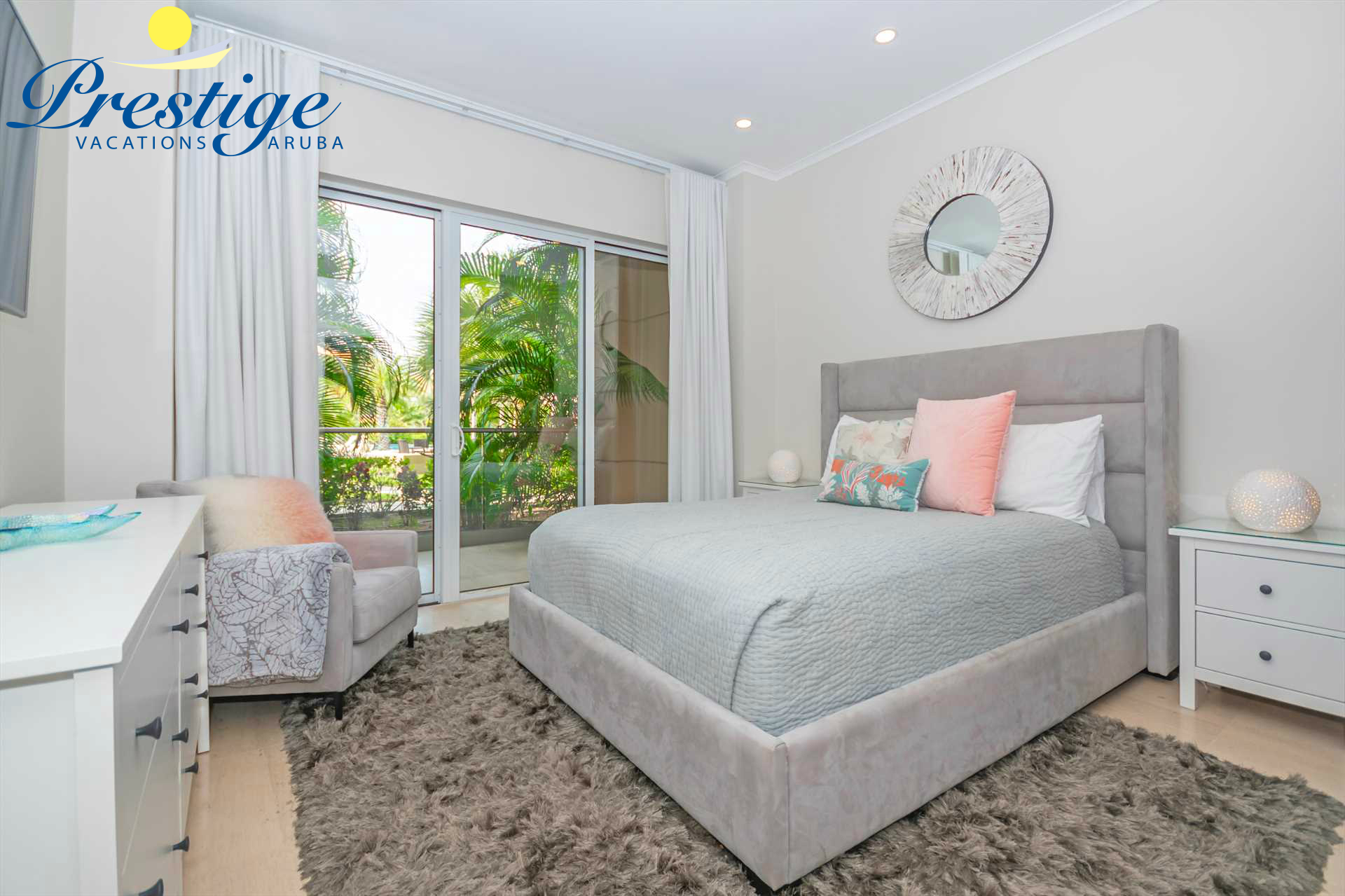 Second bedroom with queen-size bed and access to the veranda