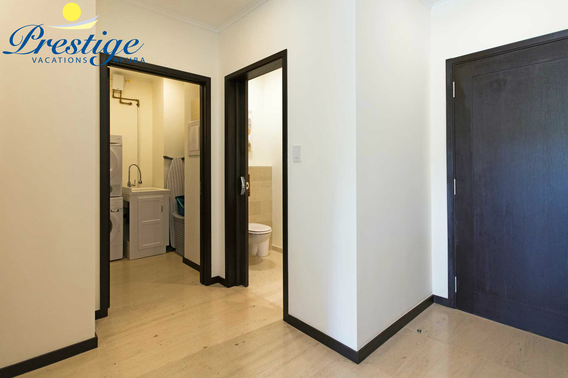 Corridor with a half bathroom and laundry room with washer/dryer