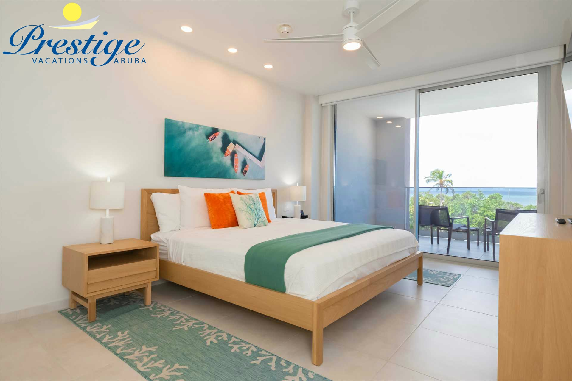 Master bedroom with king-size bed and access to the balcony with beach views