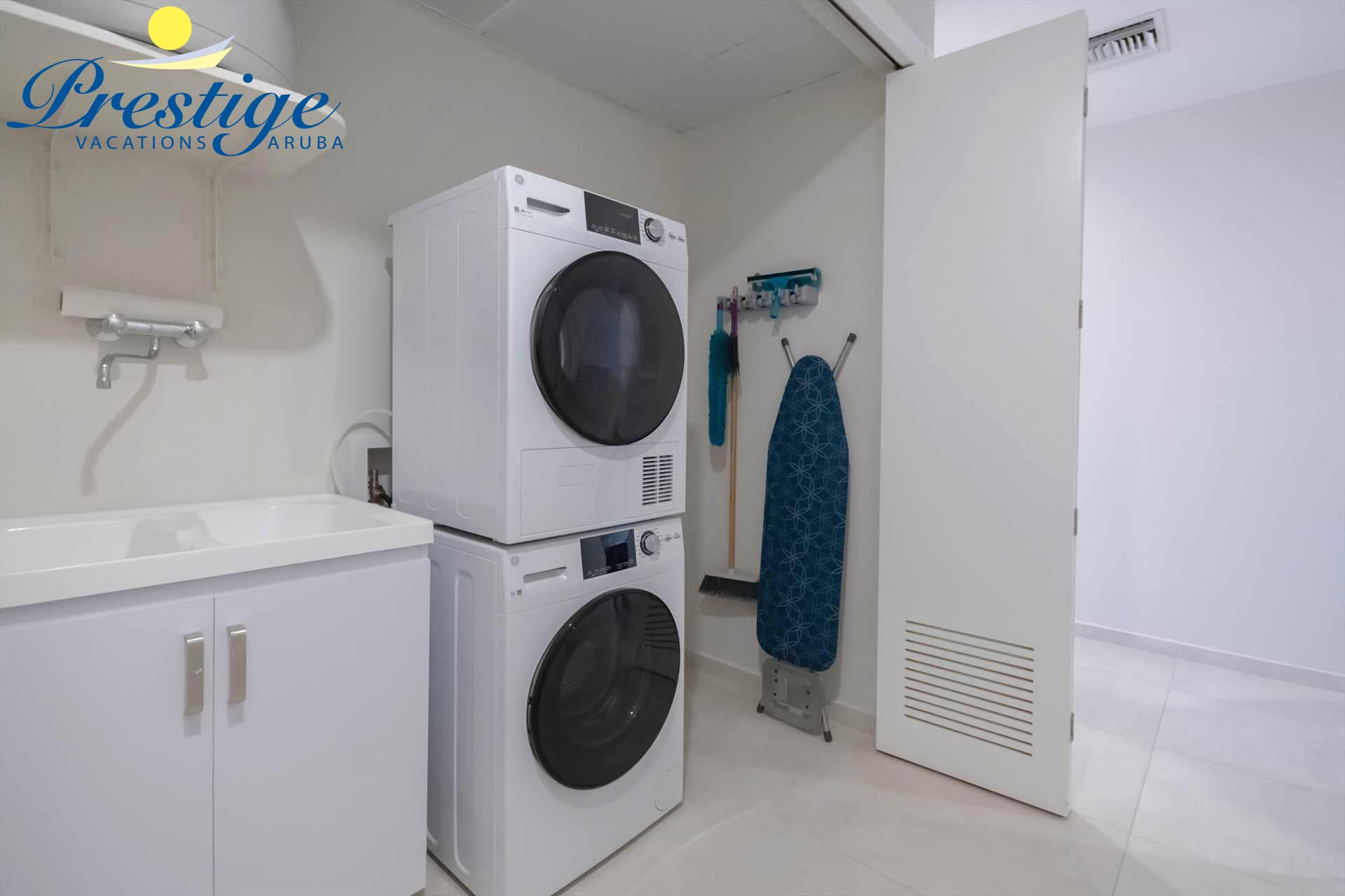 Laundry closet with a washer and dryer, there is also a half bathroom